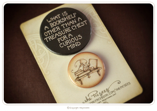 a couple of badges about books and their abode