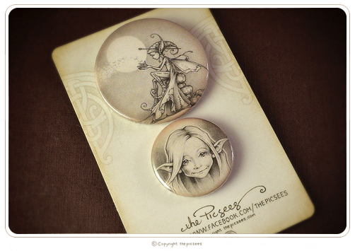 a couple of button badges featuring the wee moonlight faeries